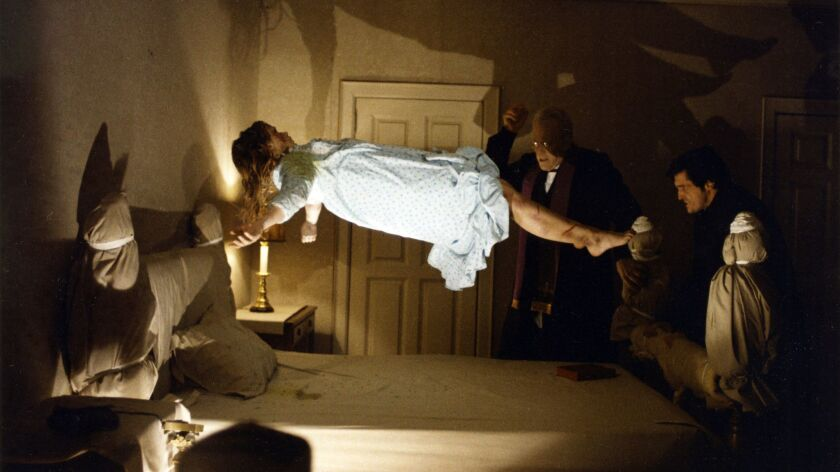 """(L-R) - Linda Blair, Max Von Sydow, and Jason Miller in a scene from """"THE EXORCIST,"""" 1973. Credit: A"""