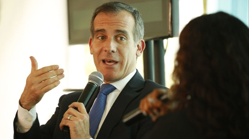 LOS ANGELES, CA - APRIL 29, 2019 - Los Angeles Mayor Eric Garcetti interviews Rhiana Gunn-Wright, ri