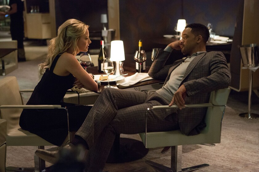 "Margot Robbie stars as Jess and Will Smith as Nicky in Warner Bros. Pictures' heist movie ""Focus."""