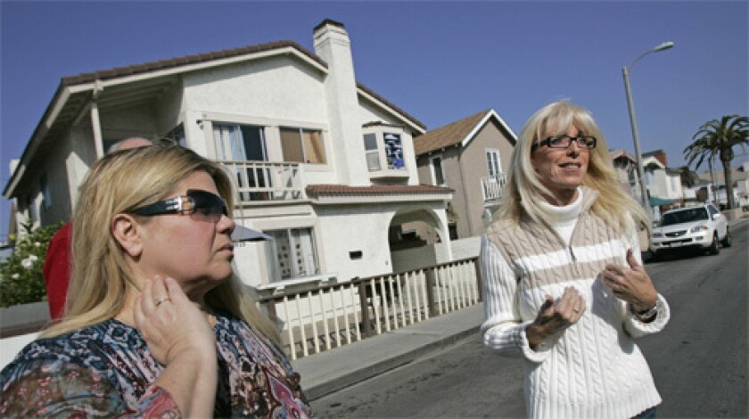 Long-time West Newport residents, Cindy Koller and Lori Morris, stand in front of house they say is one of five rehab facilities that exist on one block off 39th street in Newport Beach.