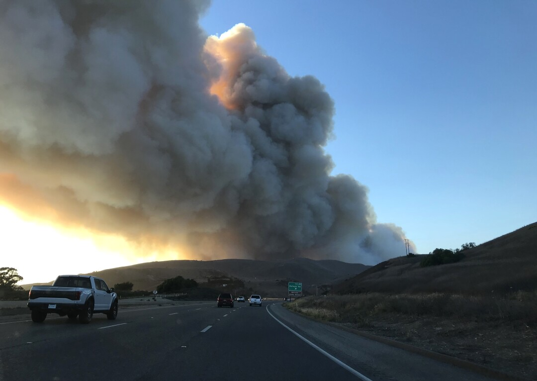 Wind drives smoke from the Alisal fire, which broke out Monday and quickly grew.