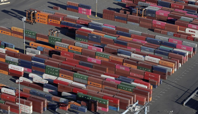 In this March 5, 2019 photo, cargo containers are staged near cranes at the Port of Tacoma, in Tacom