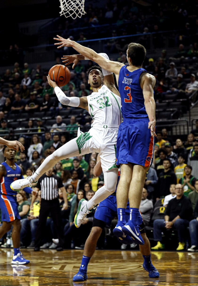 Oregon guard Anthony Mathis (32), shoots over Boise State guard Justinian Jessup (3) in an NCAA college basketball game Saturday, Nov. 9, 2019, in Eugene, Ore. (AP Photo/Thomas Boyd)
