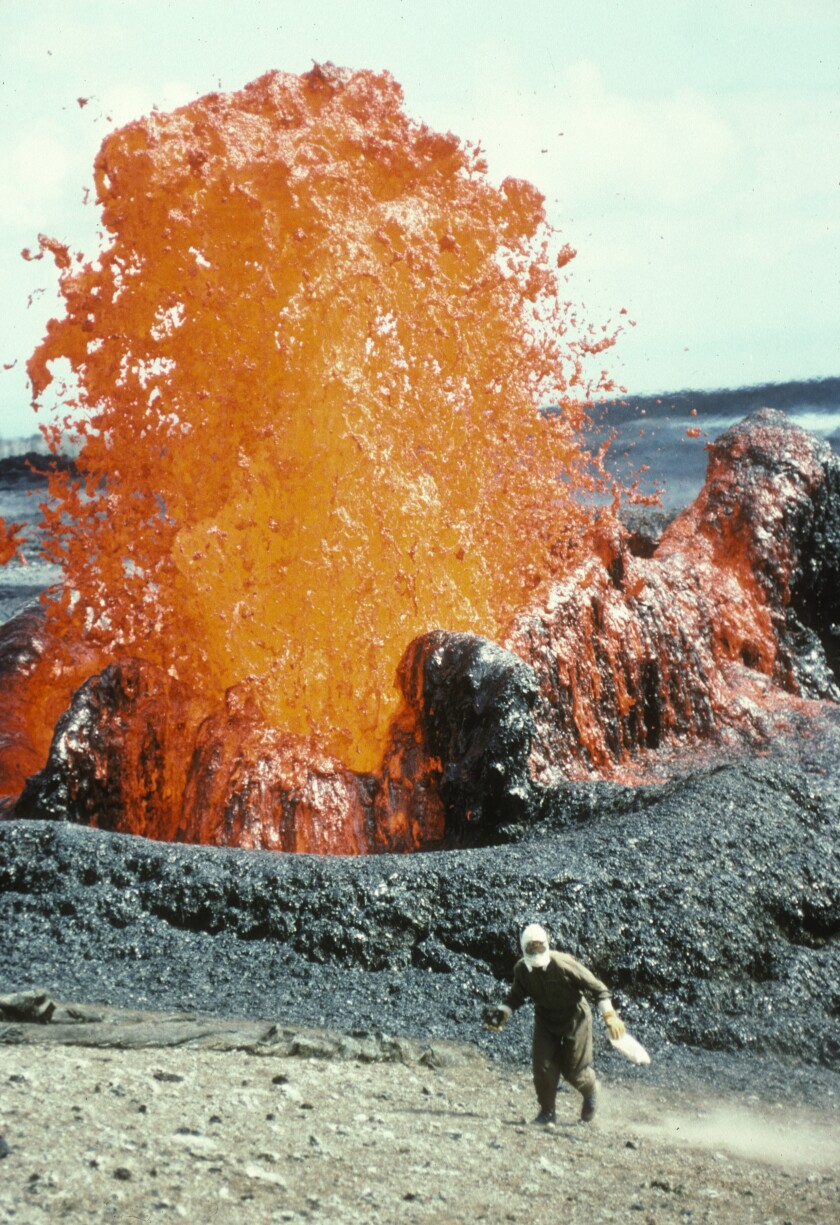 Margaret Mangan collects lava samples during a 1993 eruption of Mt. Kilauea in Hawaii