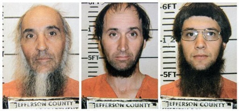 FILE - This file combo made from photos provided by the Jefferson County Sheriffs Department shows, from left, Levi Miller, Johnny Mullet, and Lester Mullet, of Bergholz, Ohio. These three men and two others suspected of forcefully cutting the beards of fellow Amish were arraigned Wednesday, Oct. 12, 2011, and released on $50,000 bonds posted by the leader of their breakaway group. (AP Photo/Jefferson County Sheriffs Department, File)