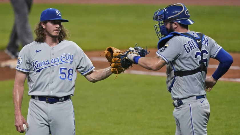 Kansas City Royals relief pitcher Scott Barlow is congratulated by Cam Gallagher after the Royals defeated the Cleveland Indians 8-6 in a baseball game Tuesday, Sept. 8, 2020, in Cleveland. (AP Photo/Tony Dejak)