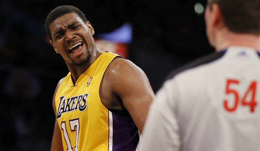 Lakers center Andrew Bynum pleads his case with referee Nick Buckert during a game.