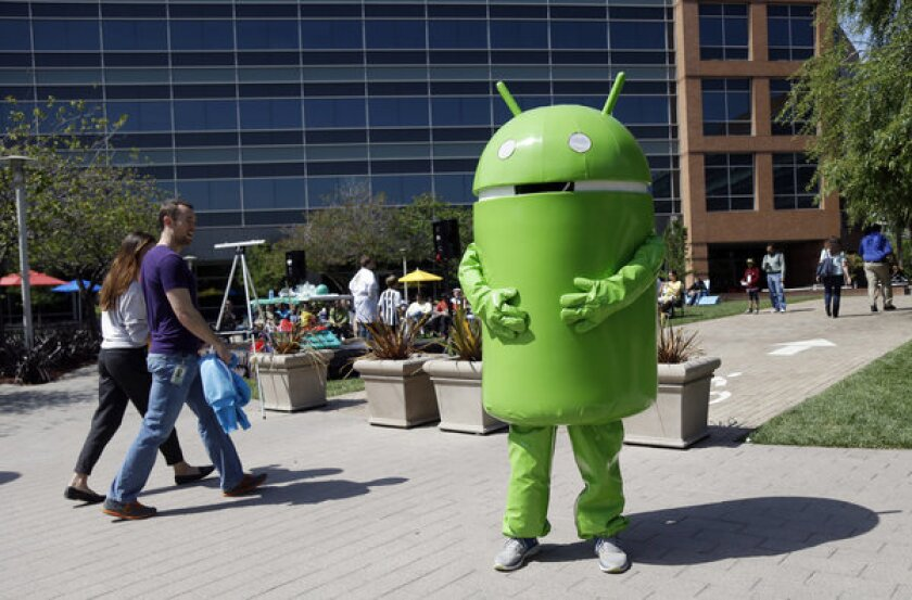 A person costumed as the Android operating system mascot at Google headquarters in Mountain View, Calif.