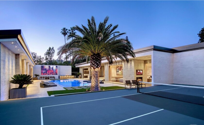 Built in 2019, the modern mansion spans 15,000 square feet with seven bedrooms and 14 bathrooms.