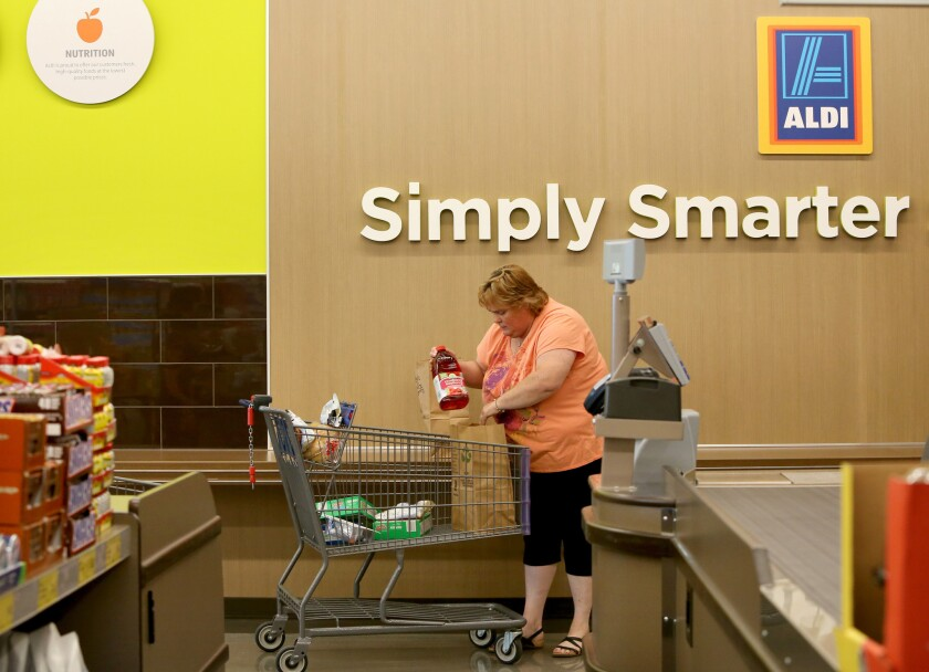 Shopper Patti Gerstenbeger bags her own groceries at the Aldi store in Niles, Ill., on Wednesday, June 10, 2015. Aldi is opening its first eight stores in Southern California on March 24.