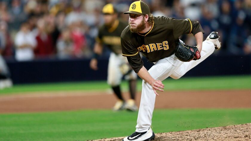 Padres Brandon Maurer delivers the winning pitch against the Yankees. The Padres beat the Yankees 7-6 Friday.