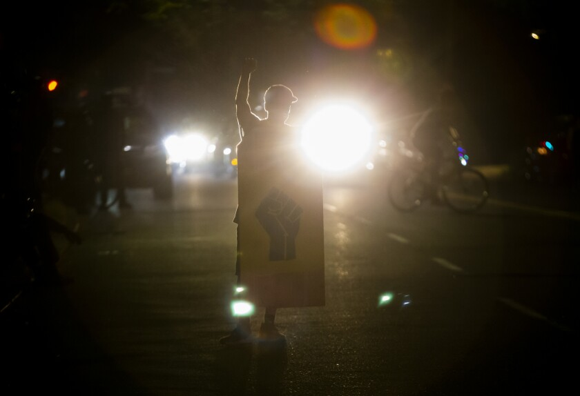 Police declared a riot around midnight as Portland protests continued for the 80th consecutive night Saturday, Aug. 15, 2020. Protesters gathered at Laurelhurst Park Saturday evening before marching to the Penumbra Kelly building. (Dave Killen/The Oregonian via AP)
