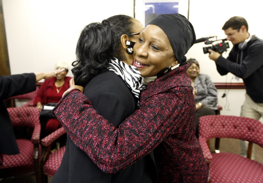 Elaine Riddick, 57, right, hugs Australia Clay after North Carolina's Eugenics Compensation Task Force votes to recommend paying $50,000 each to survivors who were sterilized under the state's eugenics program.