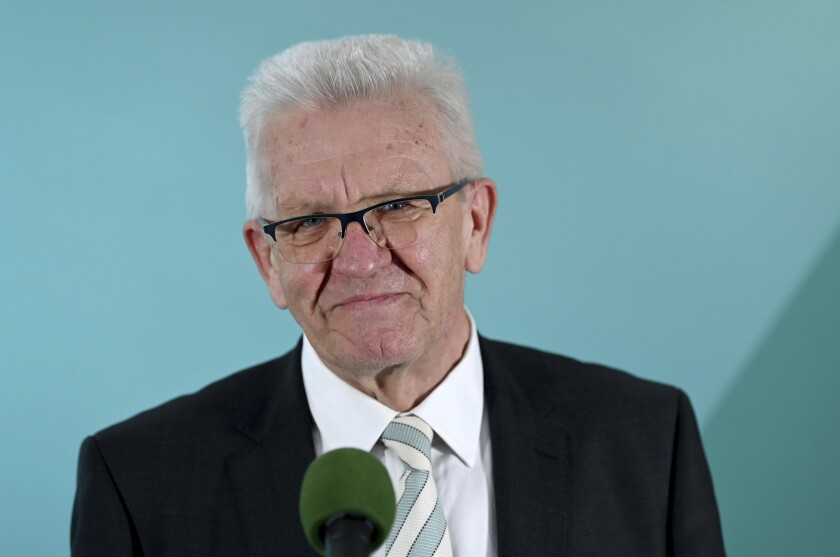 Winfried Kretschmann, Minister President of Baden-Wuerttemberg and top candidate of the Green Party, comments on the results of the state elections in Baden-Wuerttemberg in the House of Representatives in Stuttgart, Germany, Sunday, March 14, 2021. Exit polls are pointing to defeats for Chancellor Angela Merkel's center-right party CDU in two German state elections.(Marijan Murat/dpa via AP)