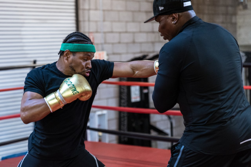 Shawn Porter, left, spars with his father, Kenny Porter.