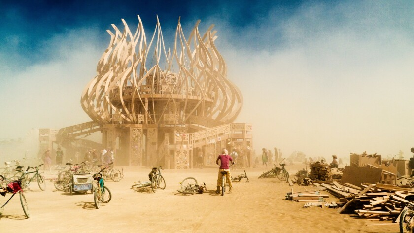 """""""Burners"""" travel to the far end the the playa, braving windstorms and extreme weather, to visit the"""