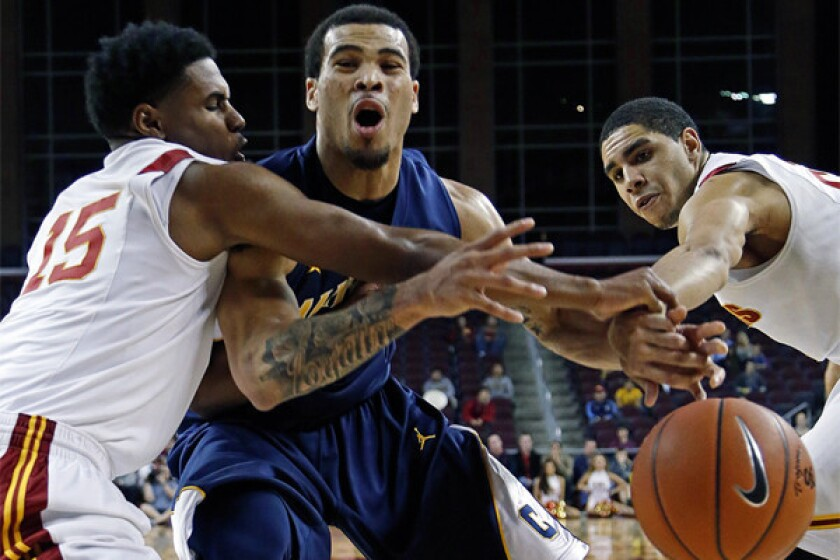 California guard Justin Cobbs tries to break through the defense of USC guard Brendyn Taylor and forward Aaron Fuller during the Trojans¿ 72-64 loss Saturday night.