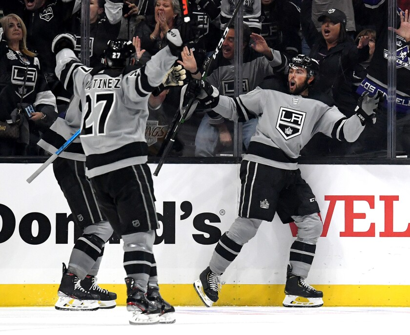 The Kings' Alex Iafallo, right, reacts to his goal go-ahead goal during a 7-4 win at Staples Center on Saturday.