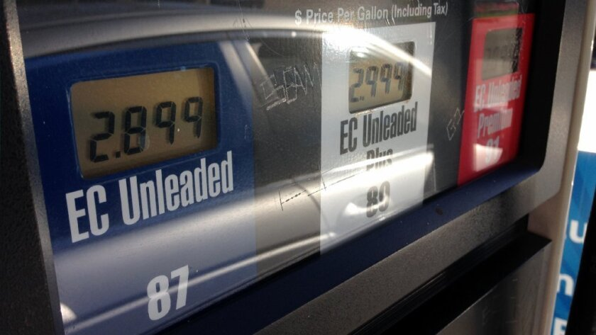 A gas pump at an Arco station in Huntington Beach on Nov. 22. At less than $60 per barrel, world oil prices have hit a five-year low.