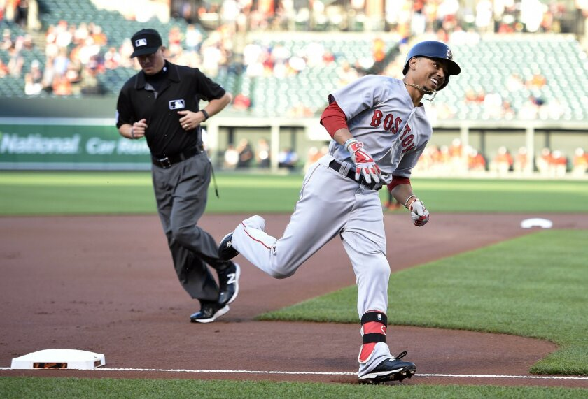 Boston Red Sox' Mookie Betts reacts as he rounds third after he hit a home run during the first inning of a baseball game against the Baltimore Orioles, Wednesday, June 1, 2016, in Baltimore. (AP Photo/Nick Wass)