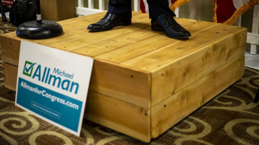 "A candidate stands on the ""soapbox,"" a platform that not many House hopefuls took advantage of at the convention."