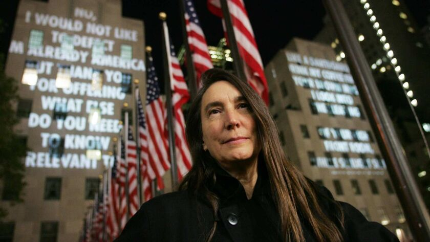 "[Jenny Holzer, the artist who conceived the public art project ""For the City,"" stands in front o"