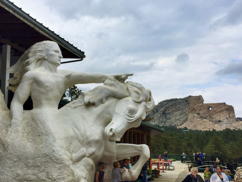The outline of the Crazy Horse monument can be seen beyond the scaled-down replica at the visitors center.