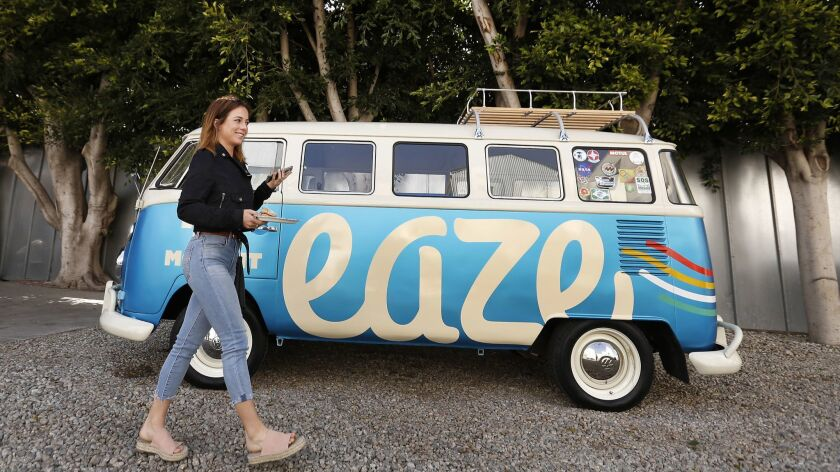 "Acacia Friedman takes a break from the ""Dawn of Cannabis"" event at EAZE L.A. headquarters in Venice on April 18, 2018. EAZE is the state's biggest cannabis delivery business and has just expanded into Venice from San Francisco."