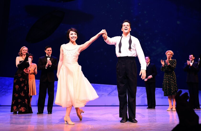 """""""An American in Paris"""" cast members take a curtain call after the opening night performance at the Palace Theater in New York on Sunday. The modernized version of the 1951 Oscar-winning film tells of the romance between a beguiling French waitress and a former American soldier working to rebuild their lives after World War II."""