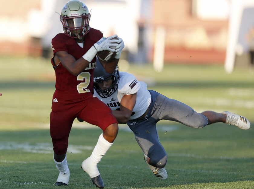 Alemany wide receiver Kevin Green Jr. makes a catch against Jordan High School (Utah)  defensive back Duane Nichols in the first quarter on Friday.