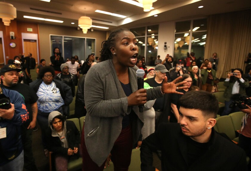 Activists disrupt the City Council meeting in Sacramento on Tuesday, a day after more than 80 people were arrested during a march through East Sacramento to protest the district attorney's decision not to bring criminal charges against the officers who fatally shot Stephon Clark.