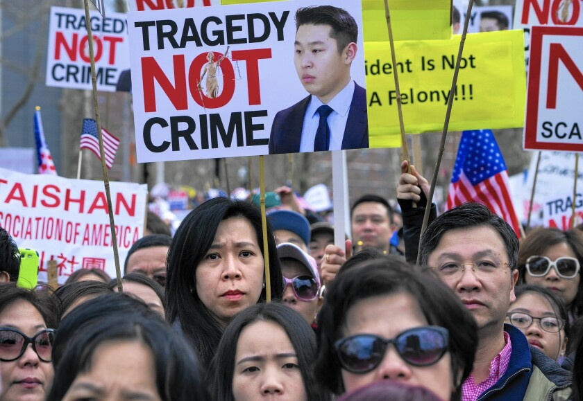 People protest in Brooklyn on Feb. 20 against the conviction of NYPD Officer Peter Liang in the shooting death of Akai Gurley.