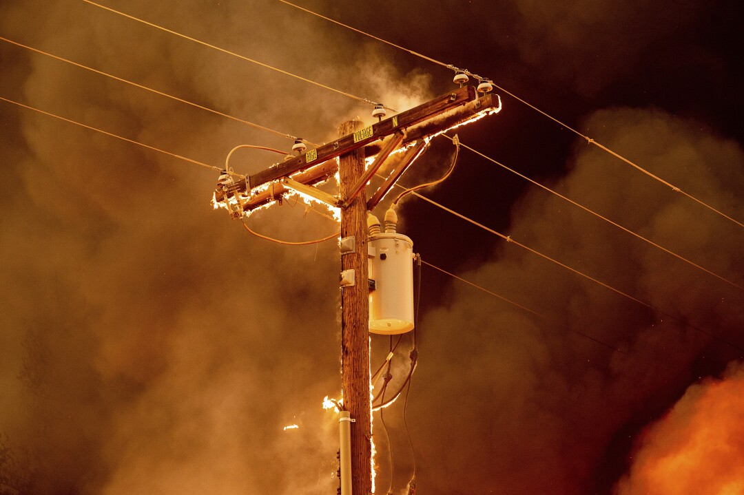A power pole in flames