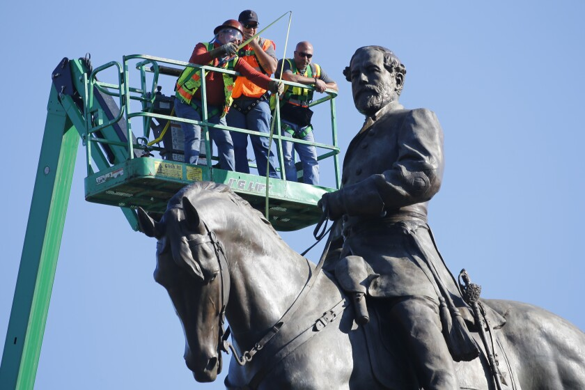 An inspection crew from the Virginia Department of General Services takes measurements as they inspect the statue of Confederate Gen. Robert E. Lee on Monument Avenue Monday June 8, 2020, in Richmond, Va. Virginia Gov. Ralph Northam has ordered the removal of the statue. (AP Photo/Steve Helber)