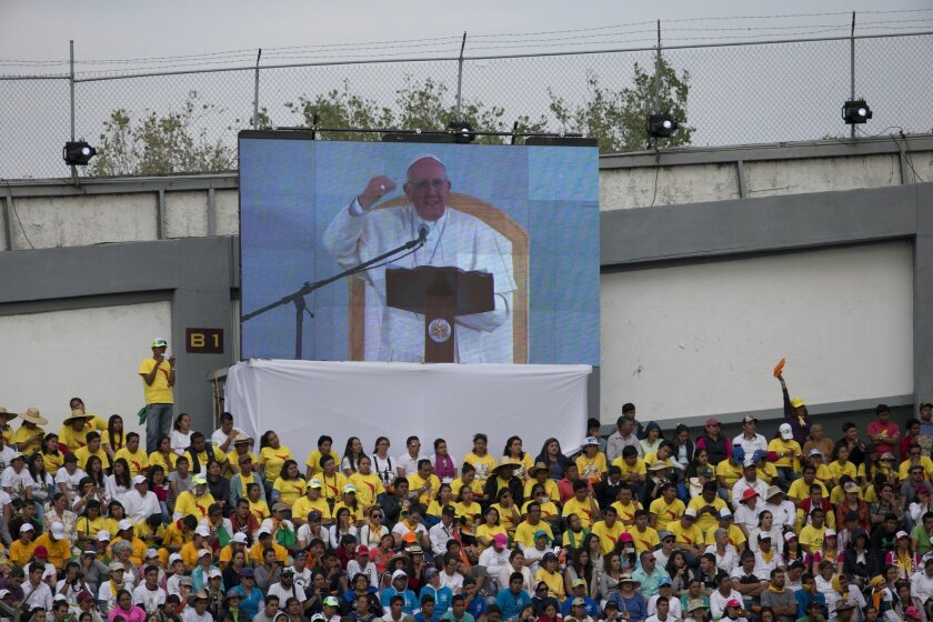 Pope Francis is seen on a big screen as he addresses Mexican youth at Jose Maria Morelos y Pavon Stadium in Morelia, Mexico, Tuesday, Feb. 16, 2016. On his one-day trip to the capital of the Michoacan state, Francis also celebrated Mass and visited the Morelia cathedral. (AP Photo/Rebecca Blackwell