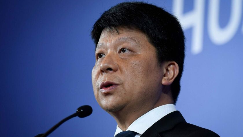 Huawei executive Guo Ping speaks at a news conference in Shenzhen, China, on Thursday.
