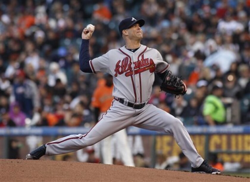 Atlanta Braves pitcher Tim Hudson throws to the San Francisco Giants during the first inning of a baseball game, Friday, May 10, 2013 in San Francisco. (AP Photo/George Nikitin)