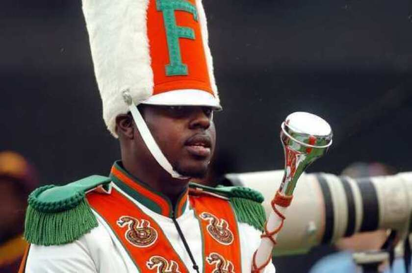Robert Champion, a drum major in Florida A&M; University's Marching 100 band, is shown performing in November. Eleven band members have been charged with felony hazing in connection with his death.