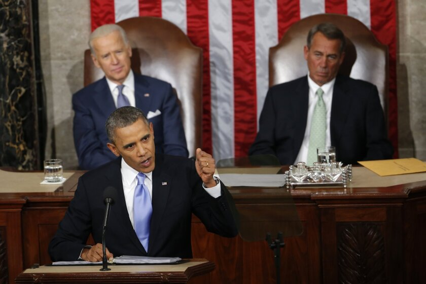 President Obama is seen delivering his State of the Union address in 2014 as Vice President Joe Biden and House Speaker John Boehner of Ohio listen. Obama delivers his 2015 address on Tuesday, Jan. 20.