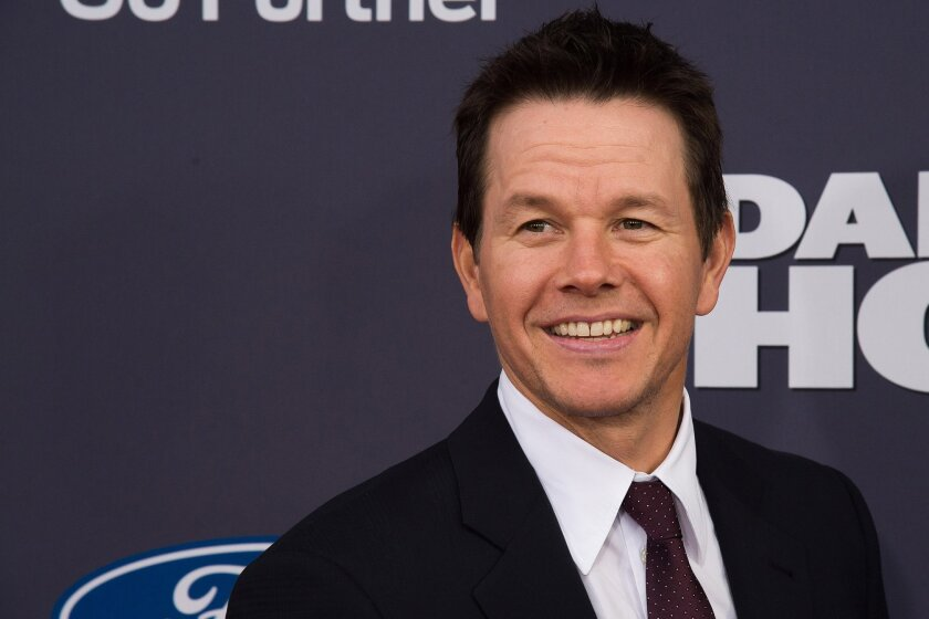 """FILE - In this Dec. 13, 2015 file photo, Mark Wahlberg attends the premiere of """"Daddy's Home"""" at AMC Loews Lincoln Square, in New York. Wahlberg and Massachusetts Gov. Charlie Baker have met to discuss a film the actor is working on. An aide for the Republican governor says the two met briefly on Wednesday, Jan. 20, 2016, to """"have a friendly talk"""" about an upcoming movie. (Photo by Charles Sykes/Invision/AP, File)"""