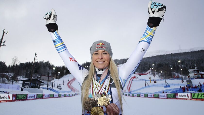 United States' Lindsey Vonn poses with her career's medals in the finish area after the women's down