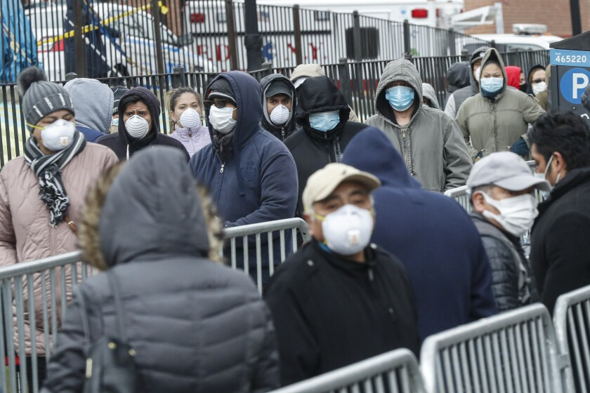 People wait in line for a COVID-19 test at Elmhurst Hospital in New York City