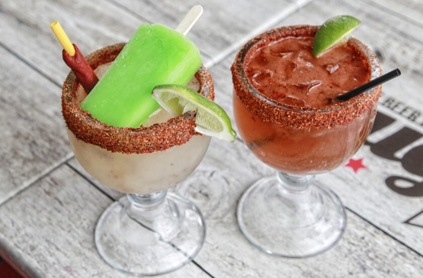 Mercado del Barrio's Dough Nations is committed to good food, good drinks — like the Badass Margarita with lime paleta (left) and a michelada — and doing good in the community.