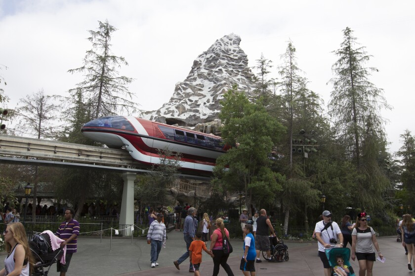 Disneyland Monorail passes by the Matterhorn Bobsled ride in the background at Disneyland during its 60th Anniversary Diamond Jubilee.