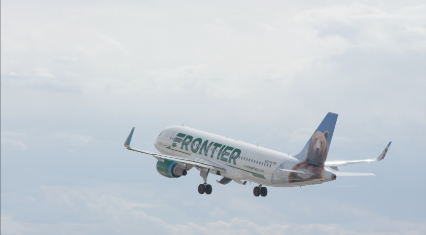 Frontier Airlines dropped plans to charge extra for folks who want to keep their distance from fellow passengers on flights.