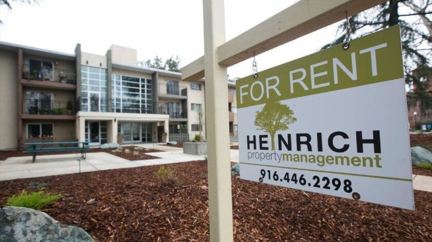 """A """"For Rent"""" sign is posted outside an apartment building in Sacramento on Oct. 6, 2018."""