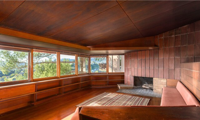 Descending three stories down a hillside lot, the Midcentury home holds three bedrooms in 1,200 square feet.