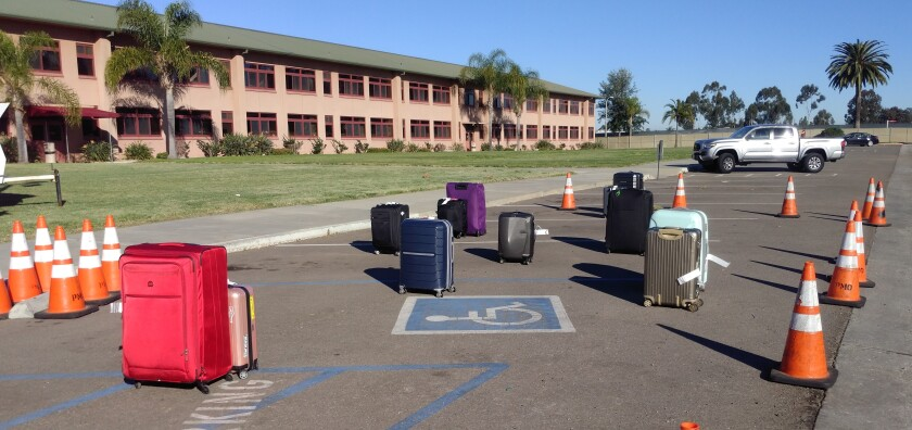 At Marine Corps Air Station Miramar in San Diego, luggage sits outside the building where Americans were evacuated from China due to the coronavirus.