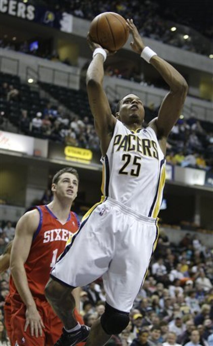 Indiana Pacers guard Brandon Rush puts up a shot while Philadelphia 76ers forward Jason Smith looks on during the fourth quarter of an NBA basketball game in Indianapolis, Tuesday, March 9, 2010. Indiana defeated Philadelphia 107-96. (AP Photo/Darron Cummings)