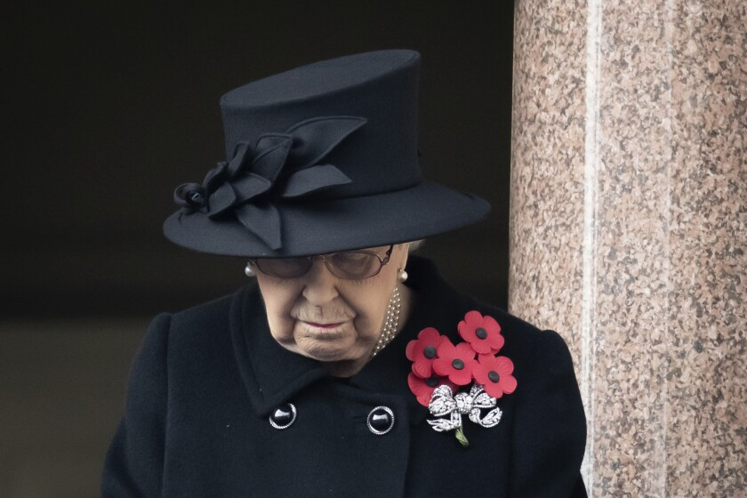 Britain's Queen Elizabeth II stands on the balcolny of the Foreign Office, during the Remembrance Sunday service at the Cenotaph, in Whitehall, London, Sunday Nov. 8, 2020. (Aaron Chown/Pool Photo via AP)